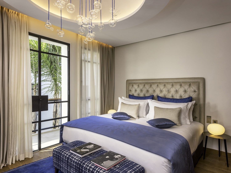 chambre lit king size hotel 5 étoiles riade à Marrakech
